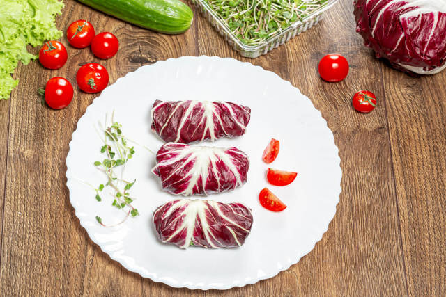 Dietary stuffed salad chicory Radicchio with vegetables and micro greenery