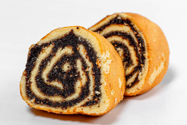 Closeup of slices of biscuit roll with poppy seed filling