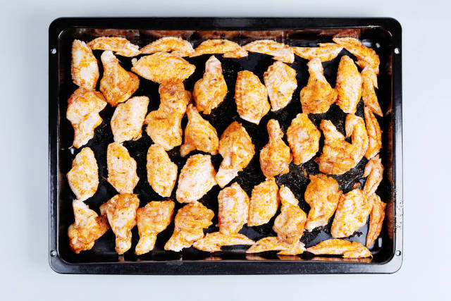 Raw chicken wings in pan, ready to be cooked