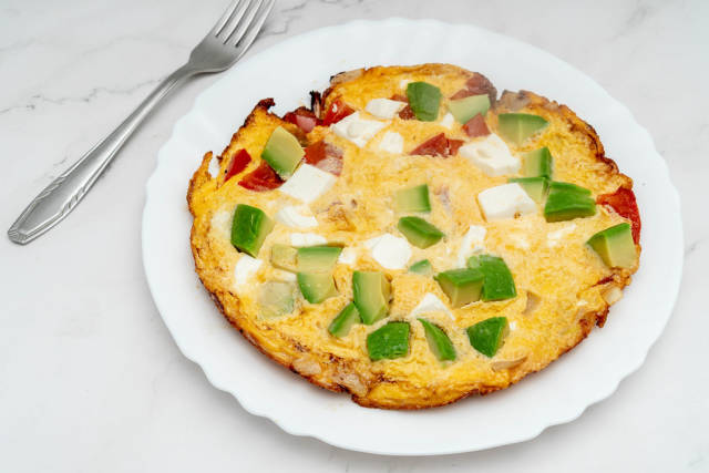 Served Omelet with Avocado Cheese and Tomatoes
