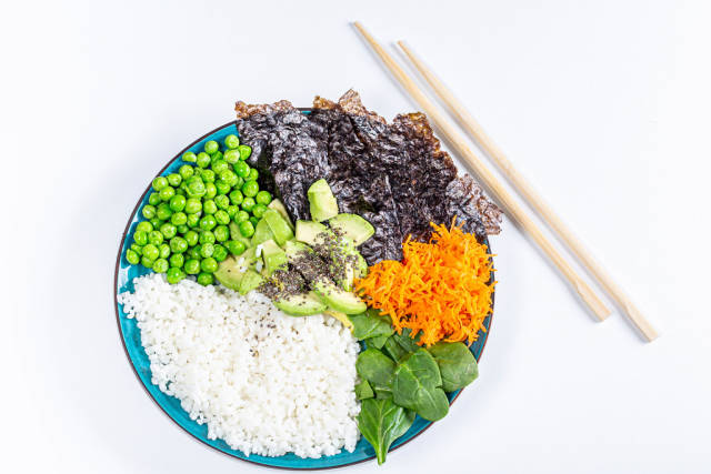 Rice with fresh vegetables, spinach and nori. The view from the top