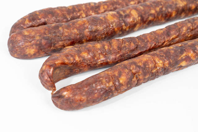 Domestic Homemade pork meat Sausages above white background