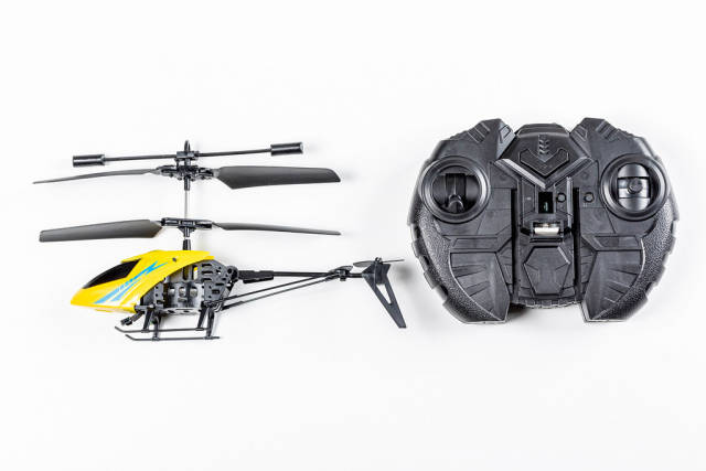 Toy helicopter with remote control on a white background