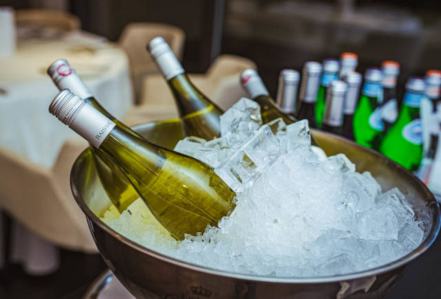 Bottles Of Wine In The Ice At The Tasting. Background, Celebration