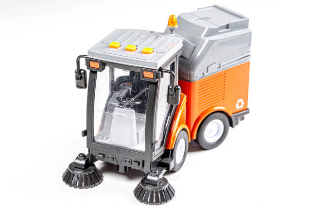 Car for cleaning roads and sidewalks on a white background. Childrens toy