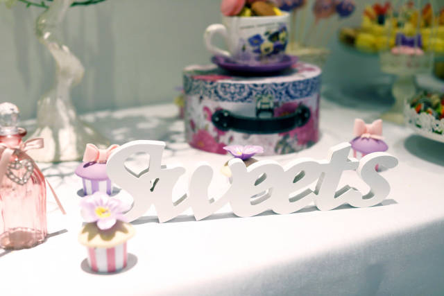 Sweets, wooden plate at the party