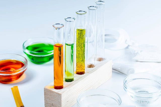 The concept of studying chemistry. Test tubes and reagents on a white background