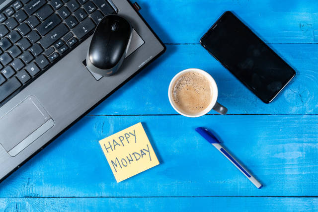 Happy Monday concept with Lap Top Mobile Phone and Cup of Coffee