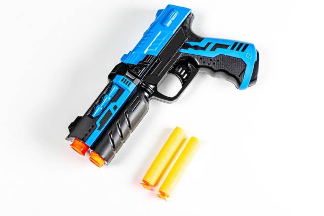 Childrens plastic pistol with cartridges