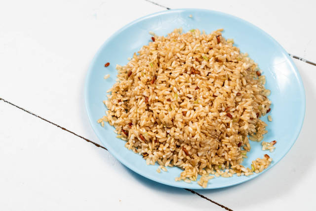 Cooked Integral Rice on the blue plate