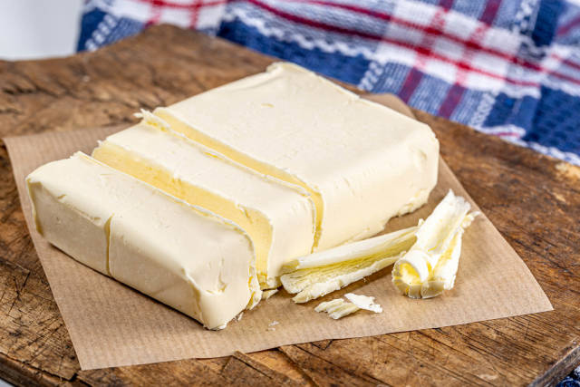 Close-up of butter on an old kitchen Board