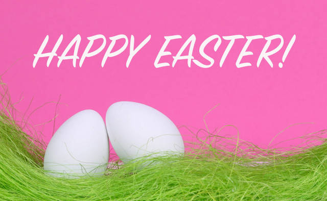 Easter eggs with Happy Easter text on pink background