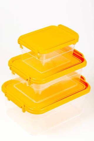 Transparent plastic food containers with orange lids