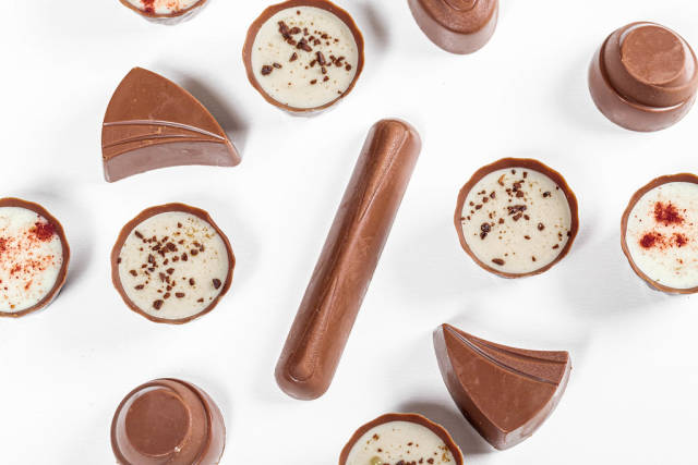 Top view assorted chocolates on a white background