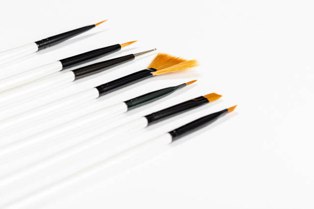 New brushes for applying makeup on a white background