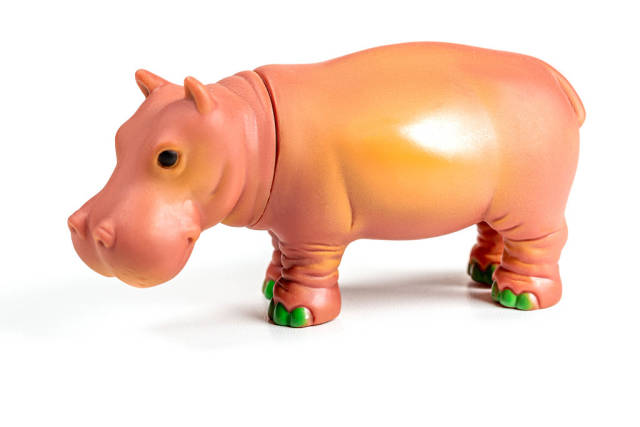 Hippo plastic toy on a white background