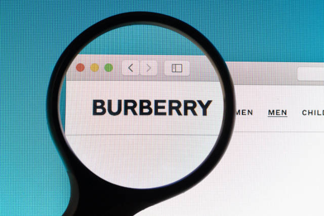 Burberry logo under magnifying glass