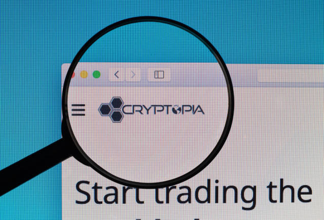 Cryptopia logo under magnifying glass