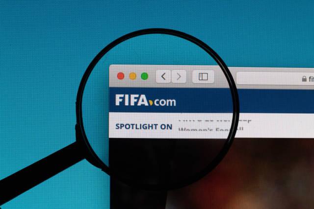 FIFA logo under magnifying glass