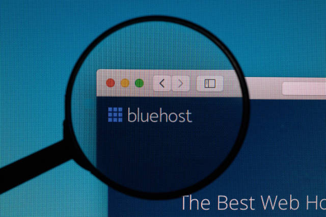 Bluehost logo under magnifying glass