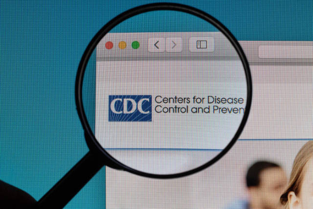 Centers for Disease Control and Prevention logo under magnifying glass