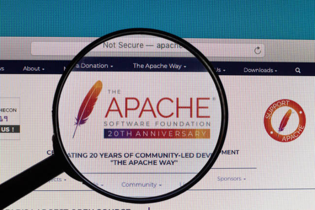 Apache logo under magnifying glass