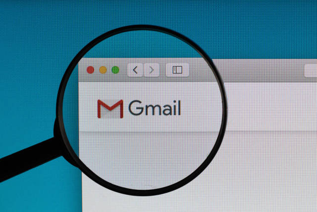 Gmail logo under magnifying glass