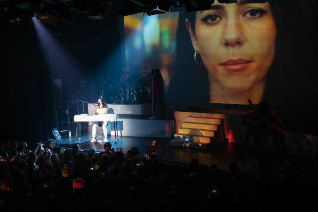 Marina plays the piano during here recent performance in Amsterdam