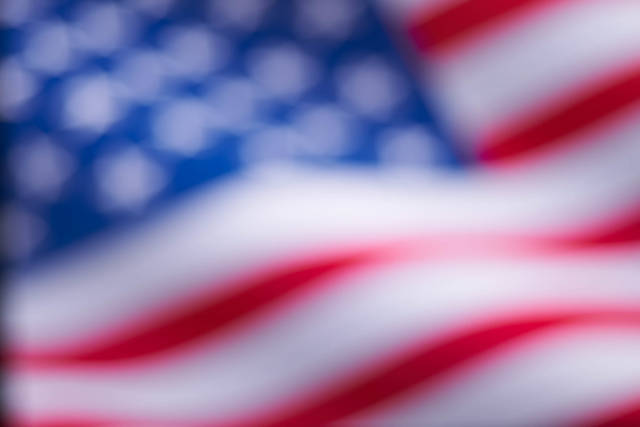 A blurred image of American national flag for background usage