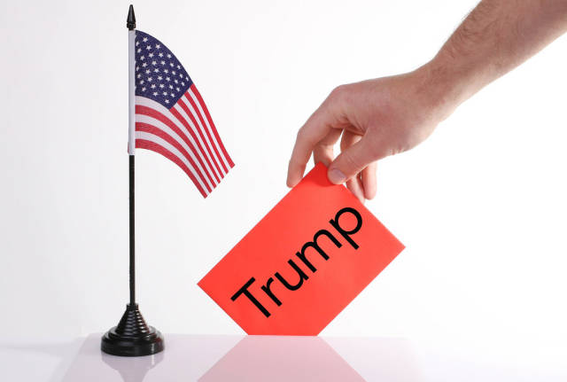 American flag and envelope with Trump text
