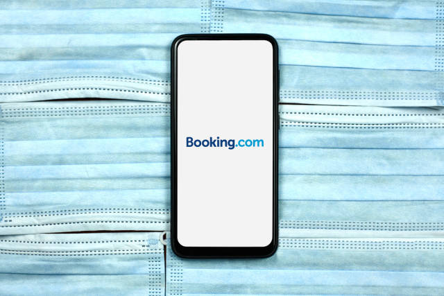 Booking.com - online travel agency for lodging reservation system logo on mobile phone