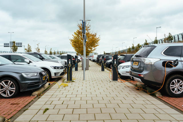 Electric cars (EV) and hybrids charging at the public charging stations in Amsterdam
