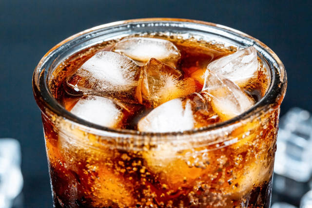 Glass of cola with ice, closeup