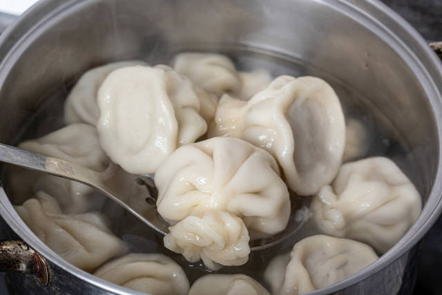 Khinkali is cooked in an iron pot