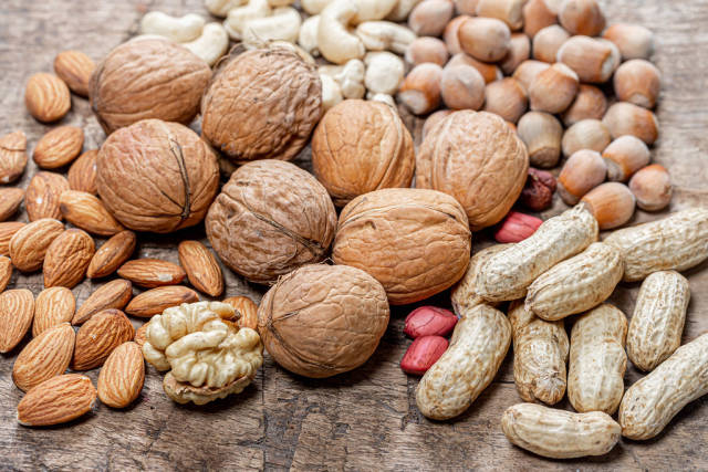 Various nuts on an old wooden background (Flip 2019)