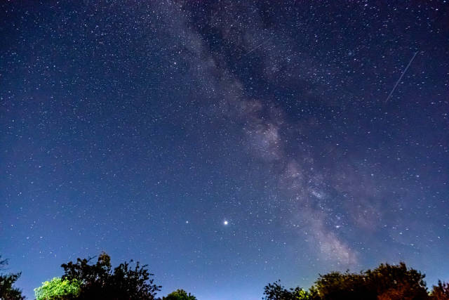 Landscape with Milky Way. Night sky with stars at summer