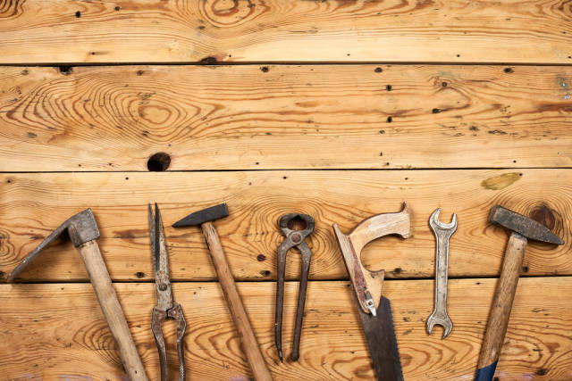 Tools on wooden background with copy space