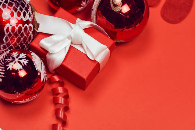 New year background on red with decorative toys and present box