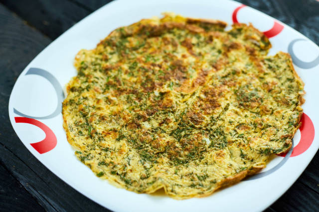 Freshly cooked homemade omelet with herbs