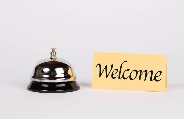 Hotel bell with welcome sign