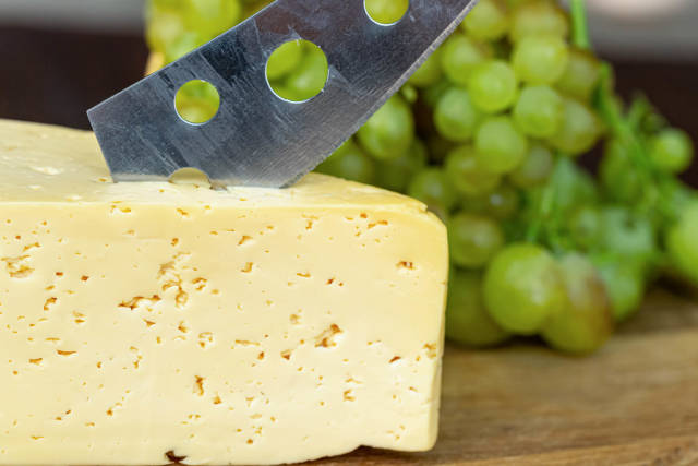 Close-up, cheese with a cheese knife