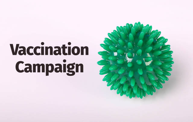 Coronavirus Bacteria concept with Vaccination Campaign text