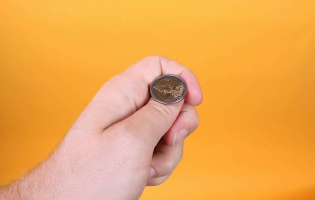 Hand prepare for flip a coin