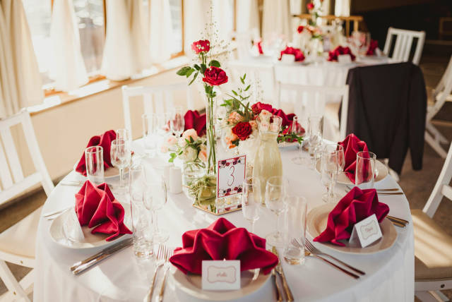 Wedding Table Serving Indoors With Red Roses