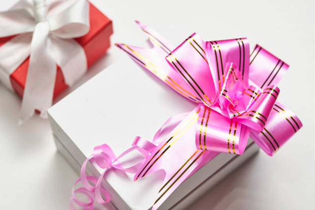 present box packed with pink festive ribbon
