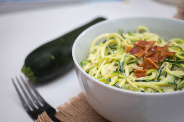 Zucchini pasta in a white bowl close-up