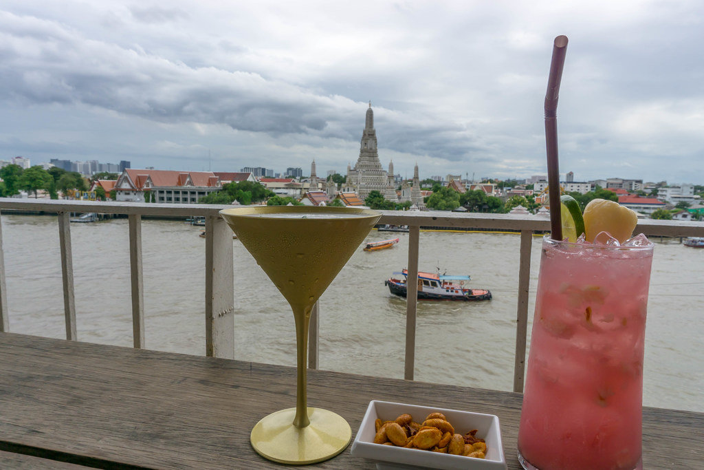 Cocktails and Peanuts with a View of Wat Arun Temple in Bangkok