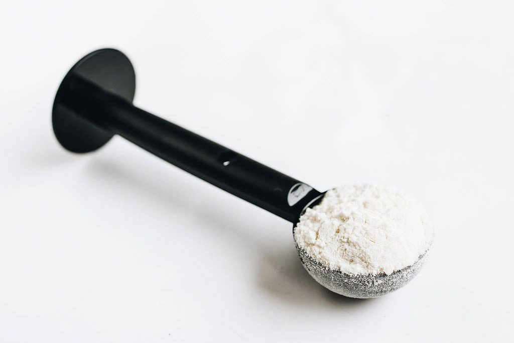 Protein powder in a spoon