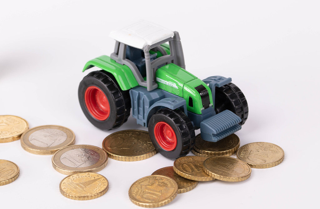 Green tractor with coins