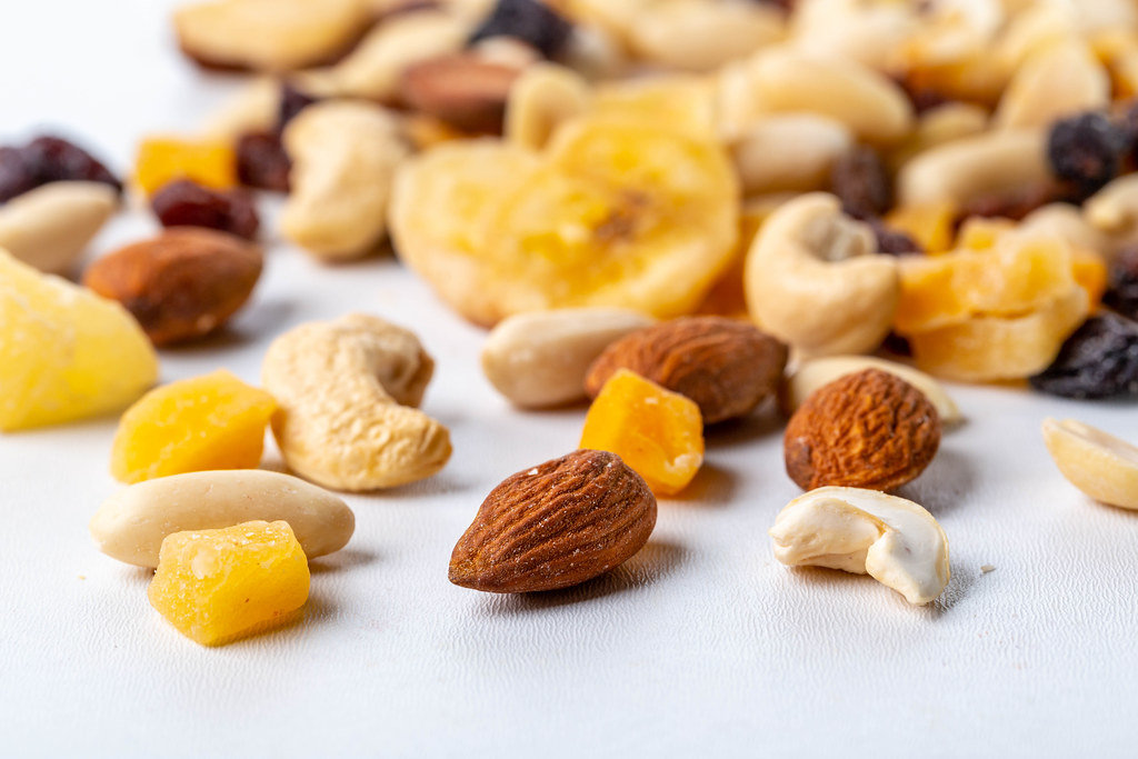 Dried fruits and different nuts on white background